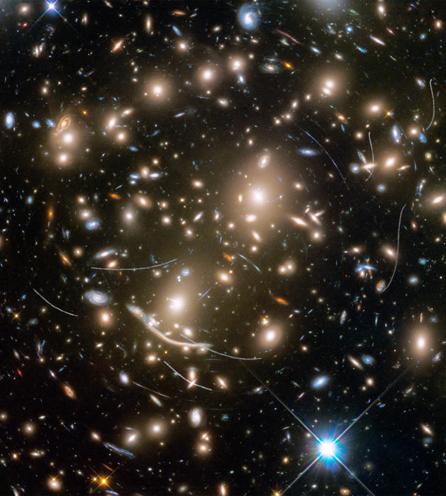 Today's Image of the Day from the European Space Agency (ESA) features the Abell 370 galaxy cluster, which is made up of several hundred galaxies pulled together by gravity
