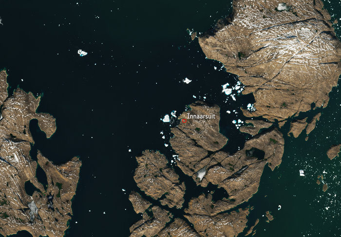 Today's Image of the Day from the European Space Agency (ESA) shows a massive iceberg moving toward the west coast of Greenland.