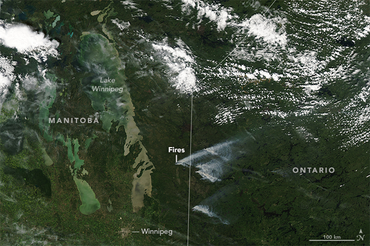 Today's Image of the Day from NASA Earth Observatory features an outbreak of fires across the border of Canada between Manitoba and Ontario.