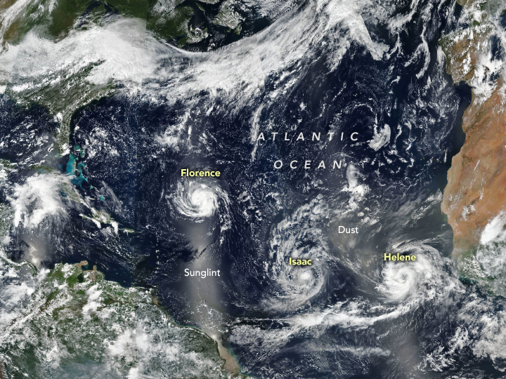 Today's Image of the Day from NASA Earth Observatory shows a trio of storms moving across the North Atlantic Ocean on September 9, 2018.