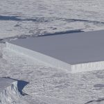 During a flight over Antarctica, NASA scientists captured an image of a mysterious, perfectly-rectangular iceberg measuring a mile in width.