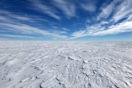 Melting ice sheets in the Antarctic region will slow down or delay atmospheric warming while accelerating sea level rise.
