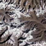 Researchers have demonstrated that the rate at which thinning glaciers move through the mountains of Asia has actually slowed down.
