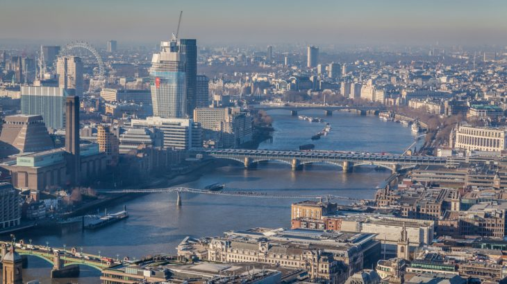 Smog darkens the London skyline. An inquest can move forward into whether London air pollution played a role in a young girl's deadly asthma attack, according to a recent court decision.