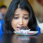 New research helps explain why cravings for junk food that seem to grow the further we get into a diet are not just in your imagination.