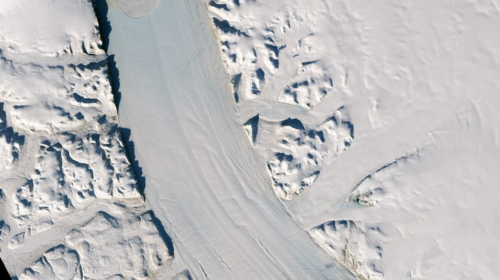 Miles of cracks along the Petermann Glacier suggest that soon an iceberg could calve from the glacier and float out to sea.