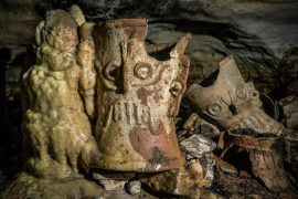 In a cave beneath the ancient city of Chichén Itzá, an archeologist found vases, ceramic incense holders, and decorated plates left untouched for centuries.