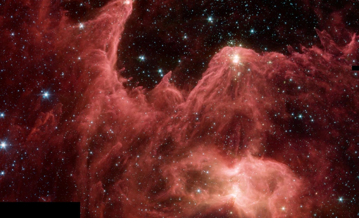 Today's Image of the Day from NASA  features a star-forming region, or nebula, captured by the Spitzer Space Telescope.