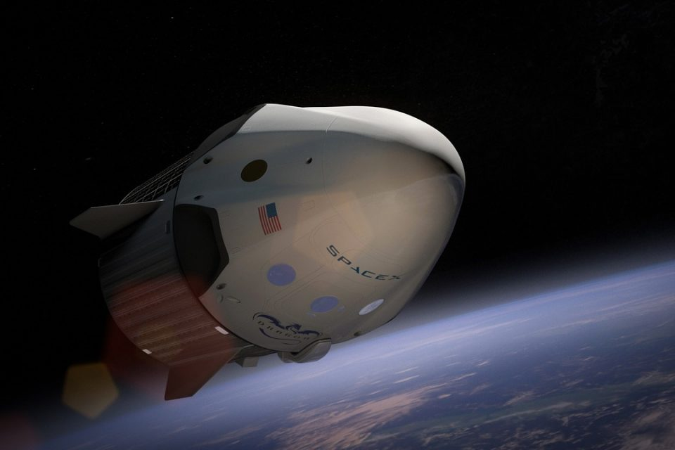 Rendering of SpaceX Dragon Capsule in orbit above the earth.