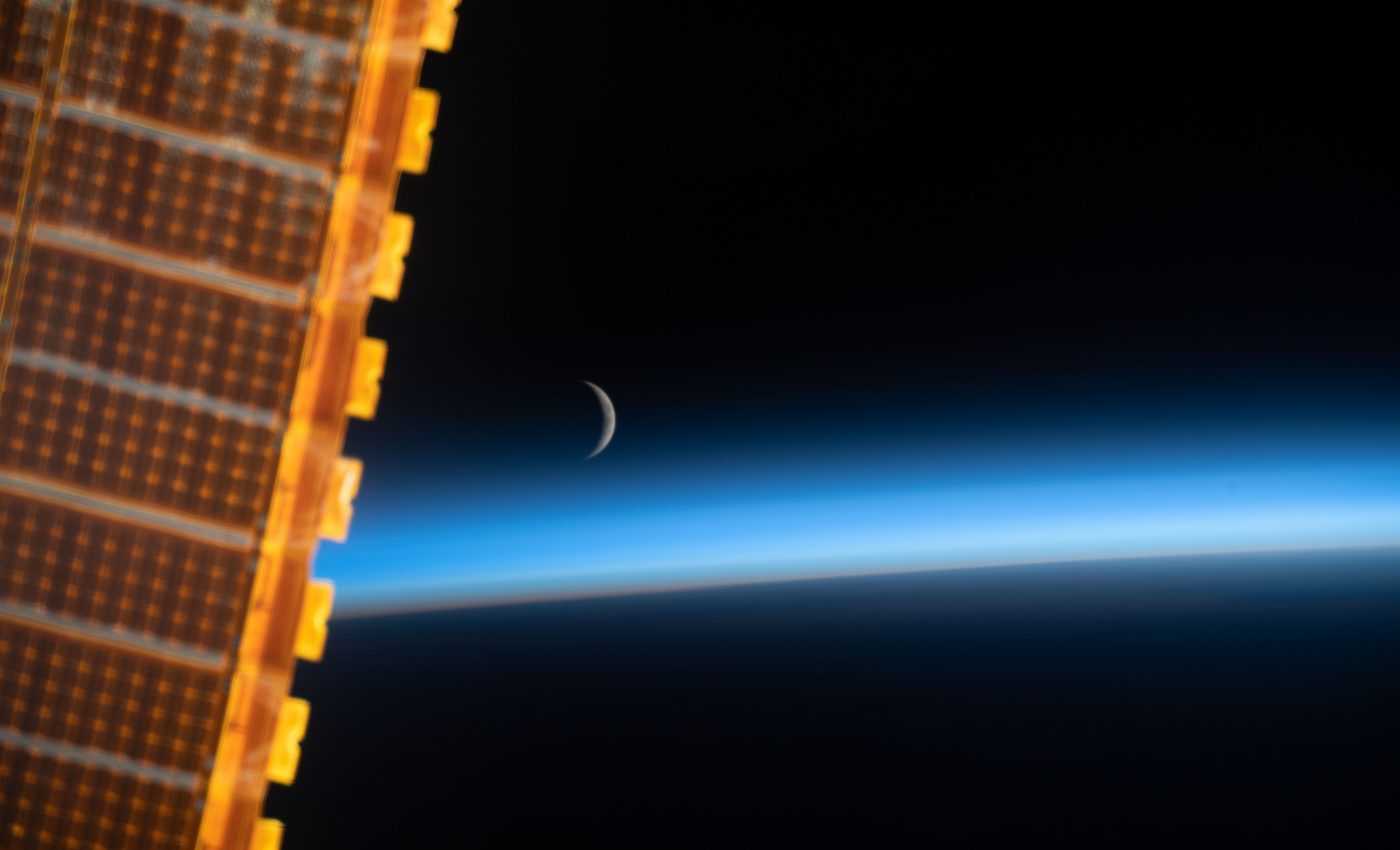 Today's Image of the Day from NASA features the waxing crescent moon just above the edge of the Earth.