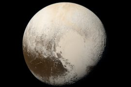 There could be a liquid ocean sitting beneath a layer of insulating gas on the dwarf planet Pluto, according to a new study.