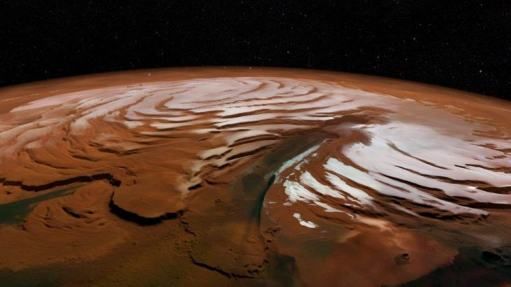 Scientists have found a surprisingly large amount of frozen water buried beneath the sandy surface of Mars.