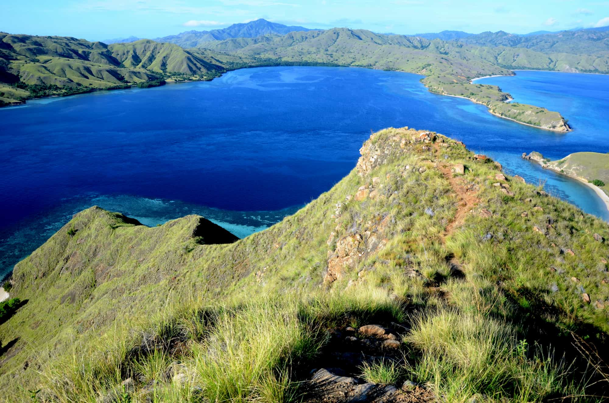 A view of the Komodo National Park with grassy islands and water visible.