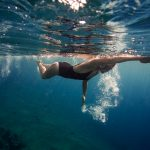 Researchers have found that a ten-minute dip in the ocean temporarily changes the skin's microbiome and potentially increases the risk of infection.