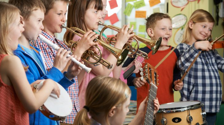 A new study has found that music students score higher on math and science exams compared to non-musical students.