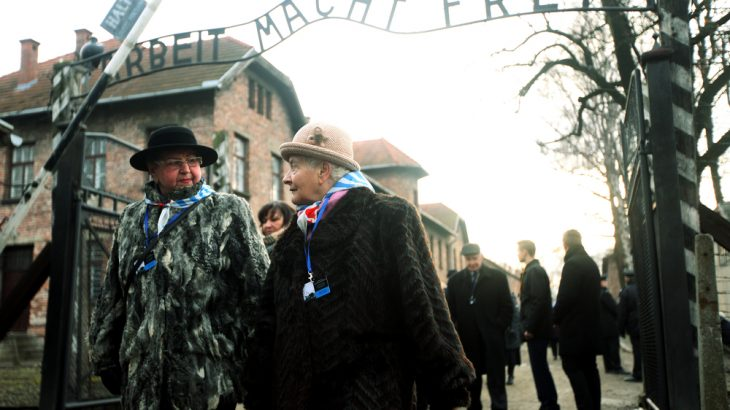 Holocaust survivors visit the site of the Auschwitz concentration camp in Poland in January 2015. A new study has found evidence of permanent changes to the brain in Holocaust survivors, which may have been passed on to their children and grandchildren. (Image credit: Praszkiewicz / Shutterstock.com)