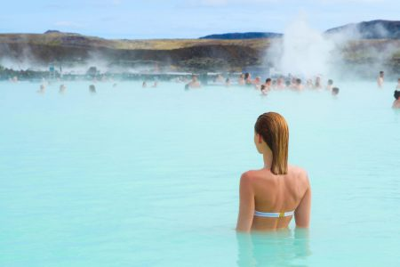 A woman enjoys one of thousands of hot springs in Iceland