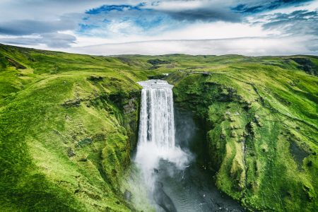 Beautiful waterfalls and lush green valley in Iceland