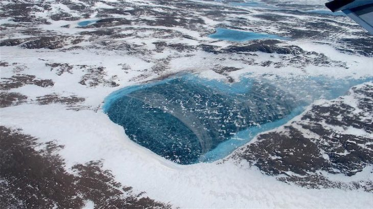 A frozen meltwater lake is near the northeast coast of Greenland's ice, as seen from NASA's P-3B aircraft on May 7, 2012. (Image credit: Jim Yungel/NASA)
