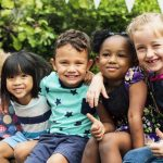 Kindergarten curriculums which involve more play, hands-on learning, and student cooperation are the most beneficial.