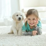 In a new study published by Springer, researchers have found that children from households with pet dogs have improved social and emotional well-being compared to kids without a dog at home.
