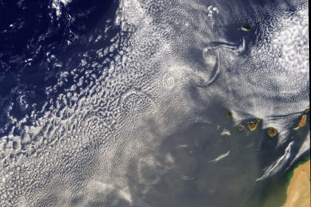 Today's Image of the Day from NASA Earth Observatory features unique cloud patterns, known as von Kármán vortices, off the west coast of Africa.