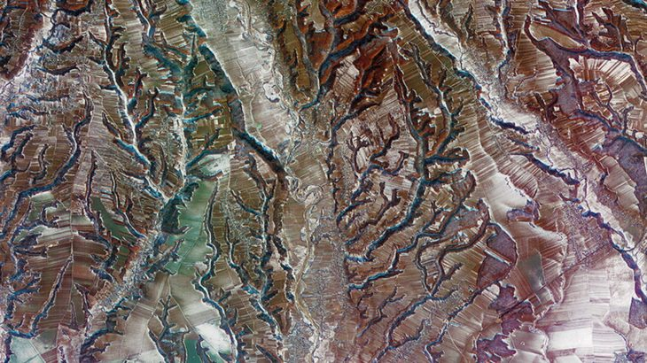 Today's Image of the Day from NASA Earth Observatory features a region of southern central Romania where the Carpathian Mountains in the north transition to lowland plains in the south.