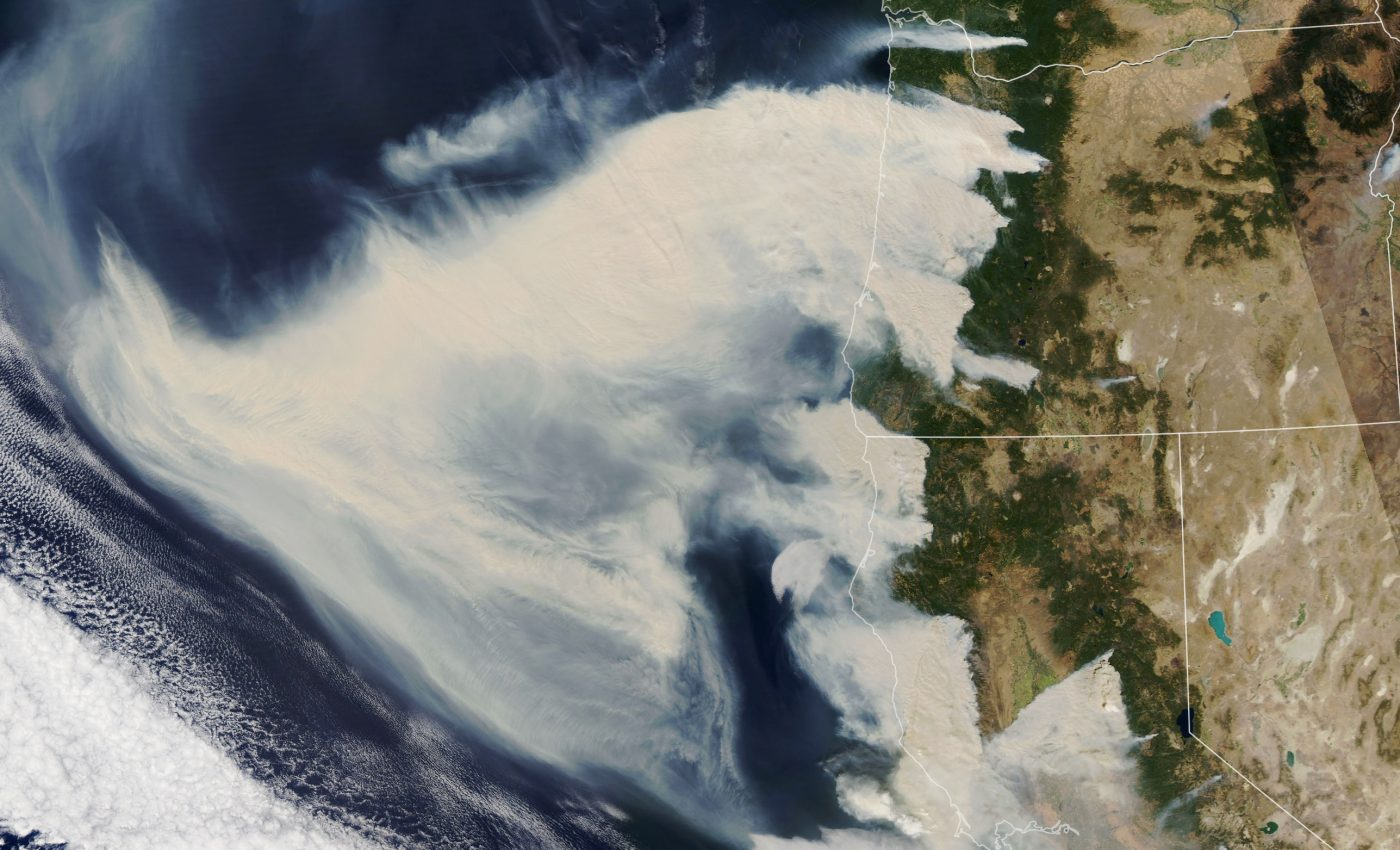 Today's Image of the Day from NASA Earth Observatory shows thick smoke plumes streaming across the western United States from dozens of fires.