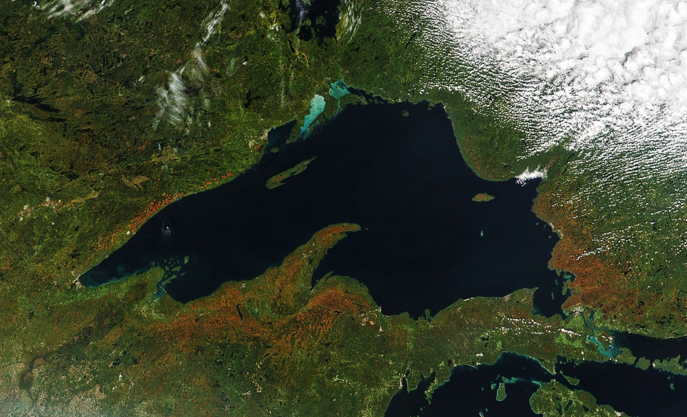 Today's Image of the Day from NASA Earth Observatory features some of the earliest fall colors emerging in forests across Minnesota, Wisconsin, and Michigan.