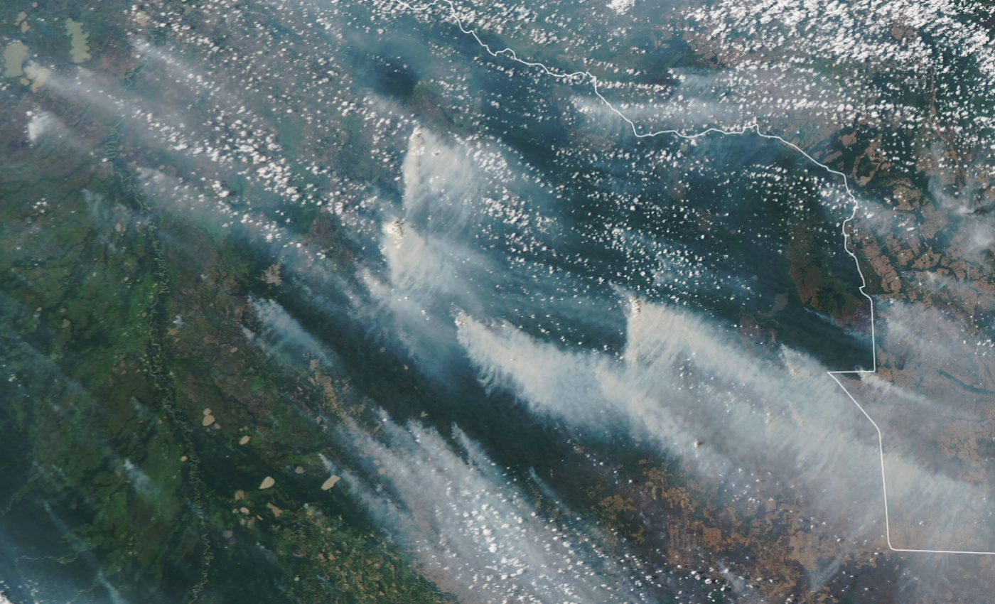Today's Image of the Day from NASA Earth Observatory shows smoke streaming from destructive wildfires across the Chiquitano forest of eastern Bolivia.