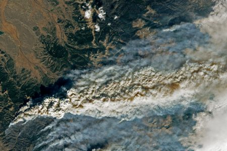 Today's Image of the Day from NASA Earth Observatory shows smoke streaming over the Rocky Mountains from the East Troublesome fire, which has now burned through more than 190,000 acres.