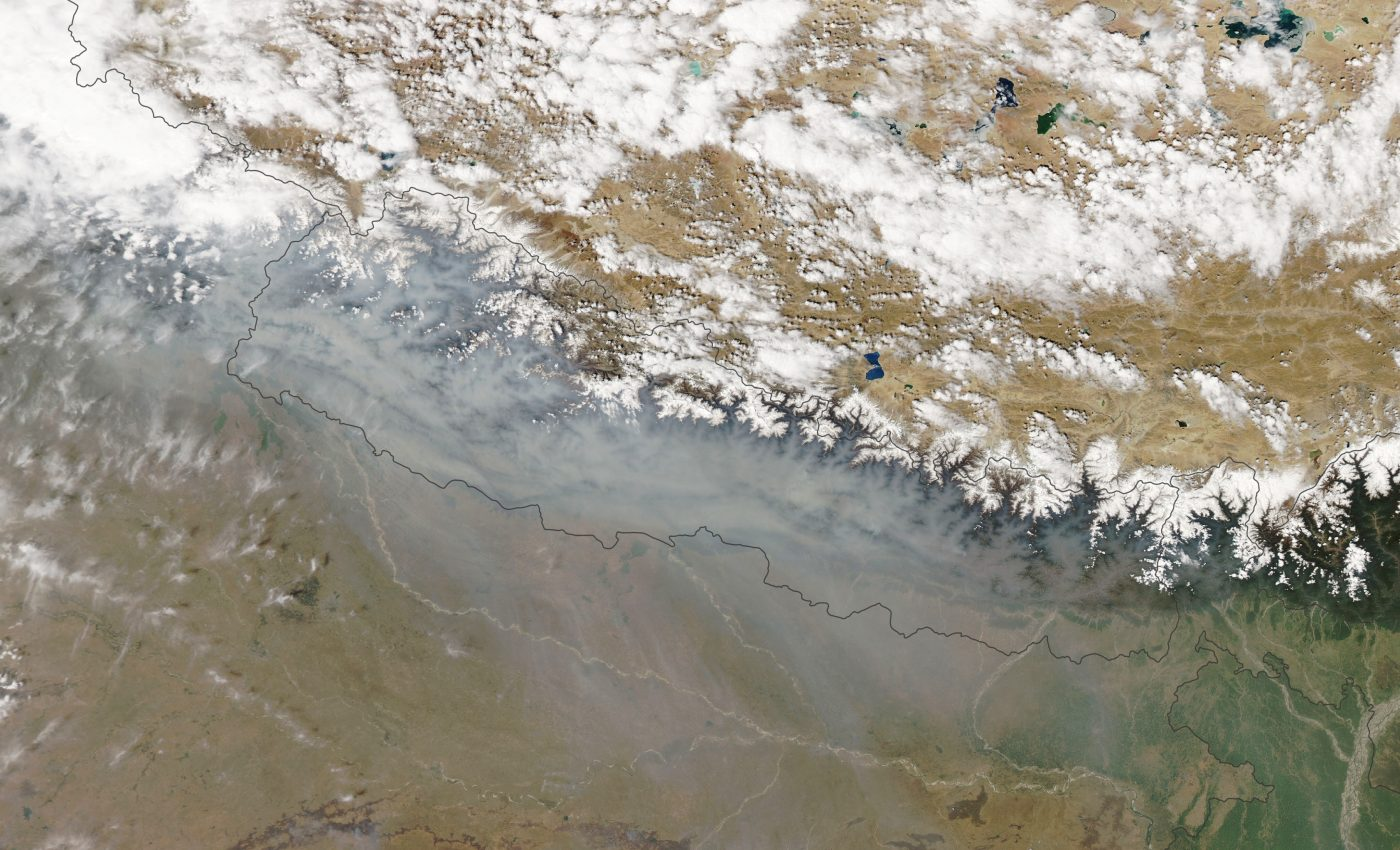 Today's Image of the Day from NASA Earth Observatory shows thick wildfire smoke across the mountains of Nepal.