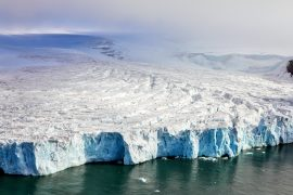 The main ice shelf that stabilizes the Pine Island Glacier is tearing away, which means the glacier will collapse into the ocean sooner than expected,