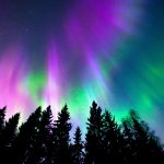 The northern lights are created by high-powered electromagnetic waves that propel electrons toward Earth at a speed of millions of miles per hour